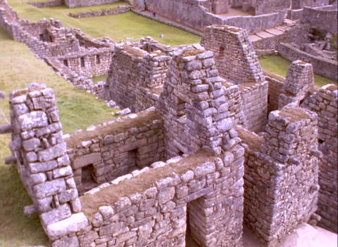 Pan across Inca ruins of Machu Picchu in Peru Stock Video Footage