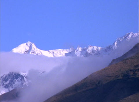Long-shot of snow-covered Andes Mountains in Peru Stock Video Footage