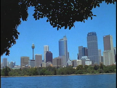 The skyline of downtown Sydney Australia is set back from Sydney Harbor Footage