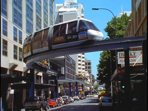 A tram curves around a street in Sydney, Australia Stock Video Footage