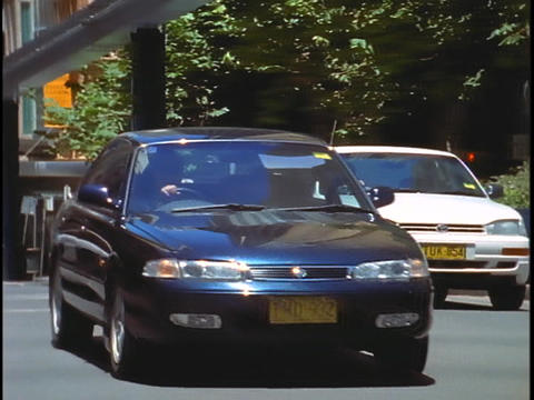 Traffic moves through the streets of downtown Sydney with... Stock Video Footage