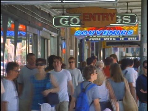 Pedestrians walk the tourist shopping district of Sydney,... Stock Video Footage