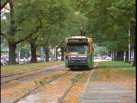 A streetcar travels on tracks in Melbourne, Australia Stock Video Footage