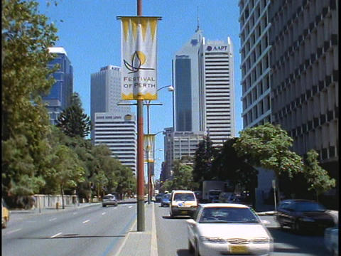 A Festival of Perth sign hangs from a light post as traffic drives by Footage