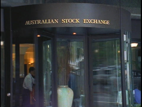 Men walk out of the Australia Stock Exchange building Stock Video Footage