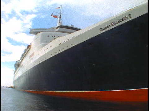 The cruise ship Queen Elizabeth 2 floats on the ocean Stock Video Footage