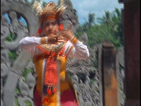A Balinese woman performs a dance Stock Video Footage