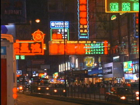 Traffic and pedestrians move along a busy street in Hong... Stock Video Footage