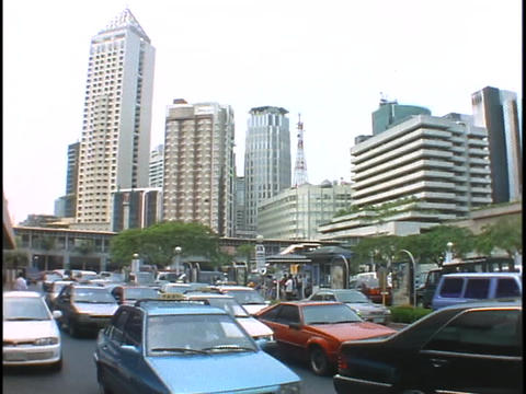 Heavy traffic drives by on a highway in Manila Stock Video Footage