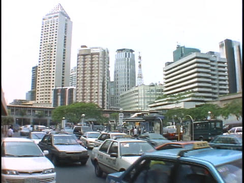 Heavy traffic drives by on a highway in Manila Footage