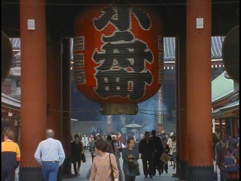 Pedestrians walk through a Buddhist temple in Tokyo, Japan Stock Video Footage