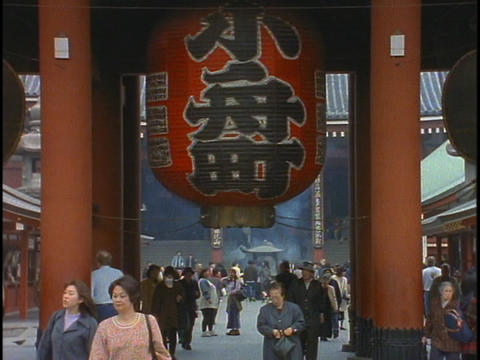 Pedestrians walk through a Buddhist temple in Tokyo, Japan Stock Video Footage
