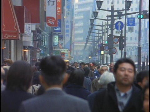 Crowds of pedestrians walk along a street in the Ginza... Stock Video Footage