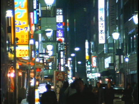 Pedestrians walk down a crowded sidewalk in Tokyo, Japan Stock Video Footage