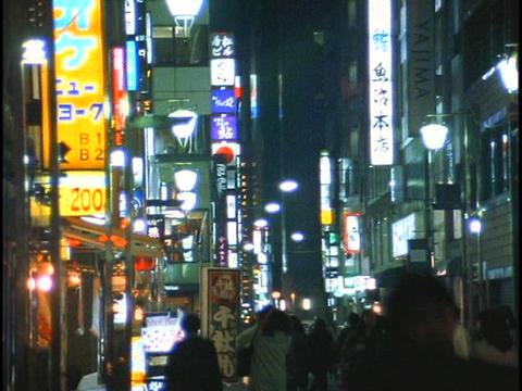 Pedestrians walk down a crowded sidewalk in Tokyo, Japan Stock Video Footage
