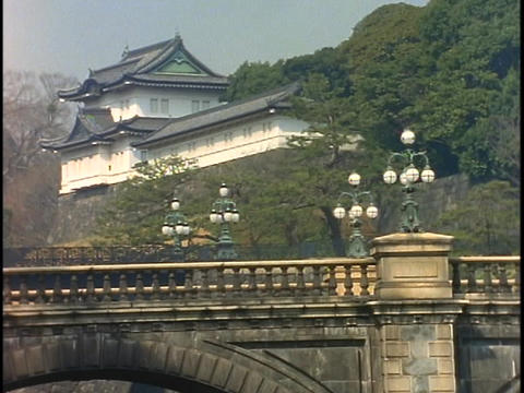 A bridge spans a river below the Royal Imperial Palace in... Stock Video Footage