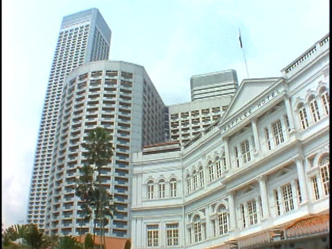The skyline of Singapore rises above the Raffles Hotel in Singapore Footage
