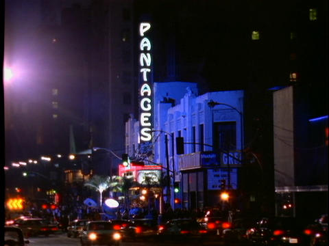 Traffic slowly passes the Pantages movie theater which is hosting a Hollywood movie premiere Footage