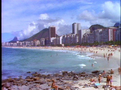 Sunbathers lie in the sand of Copacabana beach in Rio De... Stock Video Footage