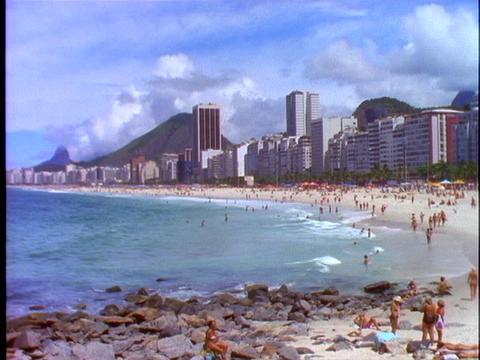 Sunbathers lie in the sand of Copacabana beach in Rio De... Stock Video Footage