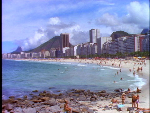 Sunbathers lie in the sand of Copacabana beach in Rio De Janeiro, Brazil Footage