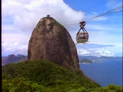 Tourists ride a tram to the top of Corcovado mountain in... Stock Video Footage
