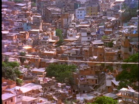 Debris flies in the air over a slum in Rio De Janeiro,... Stock Video Footage