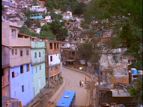A blue bus travels on a street in a slum area of Rio De Janeiro, Brazil Footage