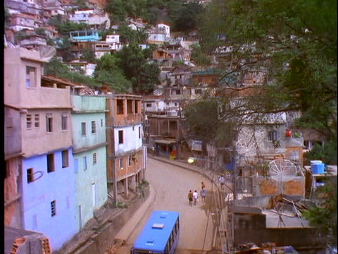 A blue bus travels on a street in a slum area of Rio De... Stock Video Footage