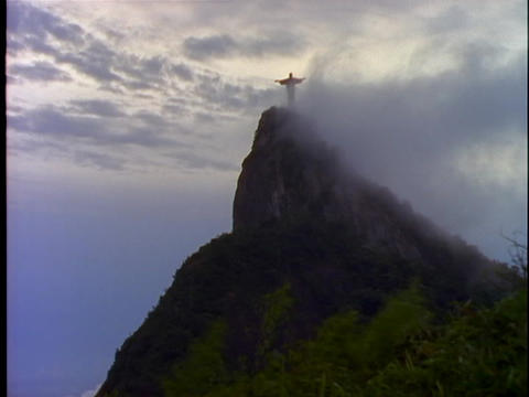 Fog rolls over the Christ The Redeemer statue in Rio De... Stock Video Footage