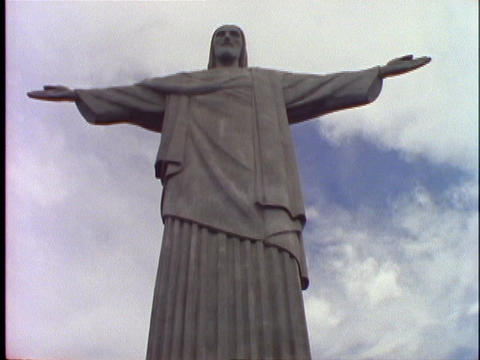 The Christ The Redeemer statue stands over Rio De Janeiro, Brazil Footage