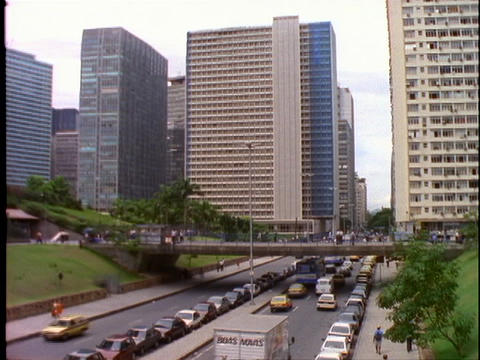Heavy traffic drives toward the business district of Rio De Janeiro, Brazil Footage