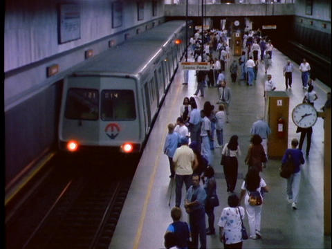 Passengers wait on the platform of a subway station in... Stock Video Footage