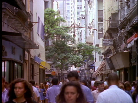 Pedestrians and shoppers walk through the crowded streets of downtown Rio De Janeiro, Brazil Live Action