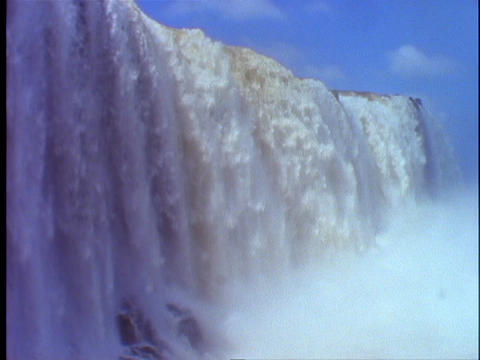 The Iguacu Falls splash into a mist Footage