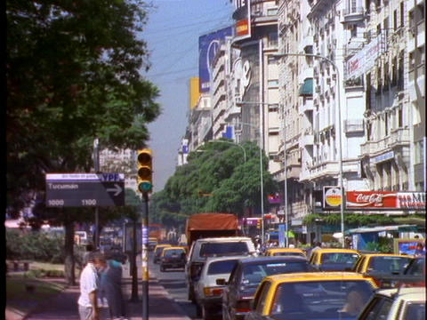 Traffic drives through Buenos Aires, Argentina Stock Video Footage