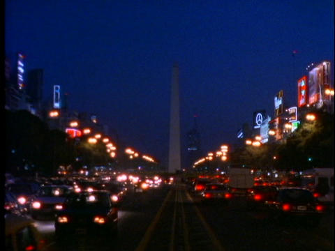 Traffic drives through downtown Buenos Aires, Argentina at night Footage
