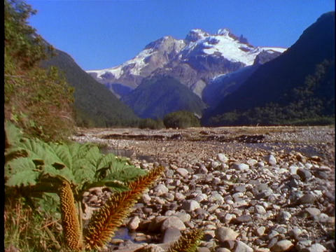 A riverbed cuts through the Andes Mountains in Patagonia,... Stock Video Footage
