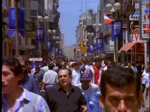 Pedestrians crowd the downtown area of Lima, Peru Footage