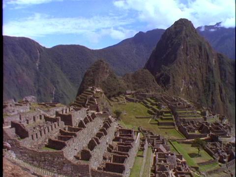 A pan across Machu Picchu Incan ruins in Peru Stock Video Footage