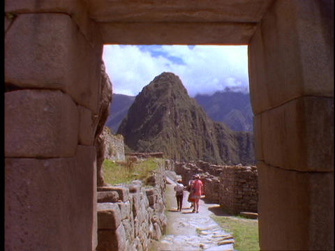 Tourists hike through the ruins of Machu Picchu Stock Video Footage