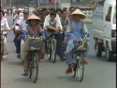 Bike traffic pedals down the streets of Saigon, Vietnam Footage
