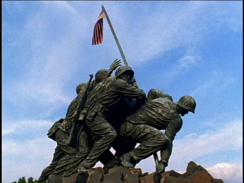 A flag ruffles in the breeze on top of the Marine Corps Memorial statue near Arlington National Ceme Footage