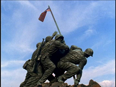 A flag ruffles in the breeze on top of the Marine Corps... Stock Video Footage