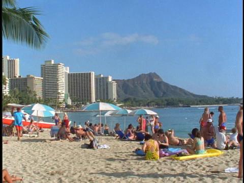 Sun-bathers crowd a beach Stock Video Footage