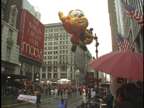 The honey bee balloon floats in the Macys Thanksgiving... Stock Video Footage
