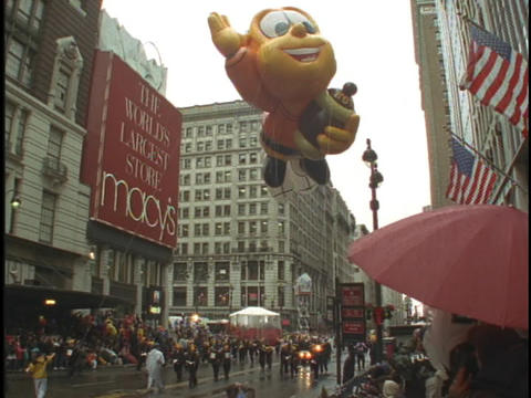 The honey bee balloon floats in the Macys Thanksgiving Day Parade Footage