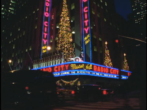 A neon sign lights the entrance of Radio City Music Hall... Stock Video Footage
