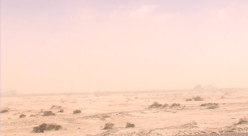 A dust storm obscures a road through the desert Footage