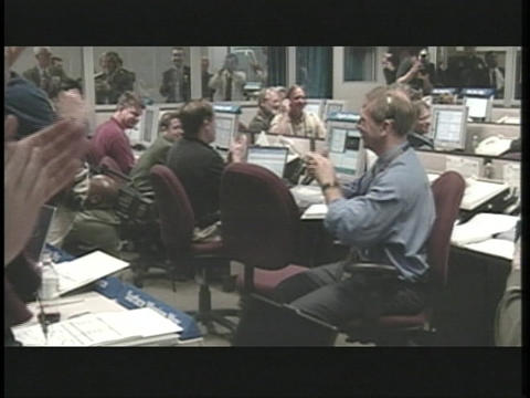 Scientists celebrate in NASA's control room Footage